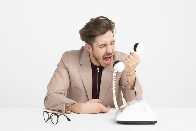 employee bullying another coworker over the telephone